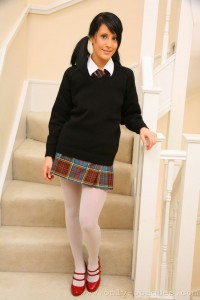 Adorable schoolgirl Emily J in her uniform and white pantyhose