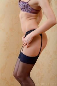 Alice in her bra, panties and sheer nylons