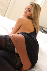Busty babe Jodie Gasson in a miniskirt and opaque stockings