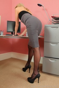 Lacey Jay in her secretary uniform and pantyhose