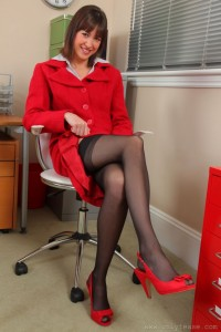 Naughty secretary Carole at the office in her heels and black stockings