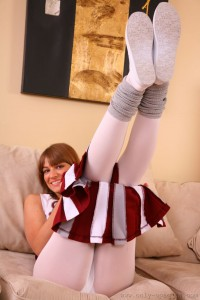 Sexy cheerleader Amy P in her leg warmers and pantyhose